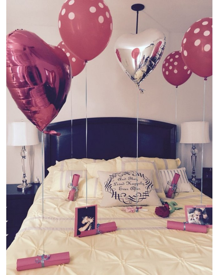 Helium gas balloons with hanging photographs