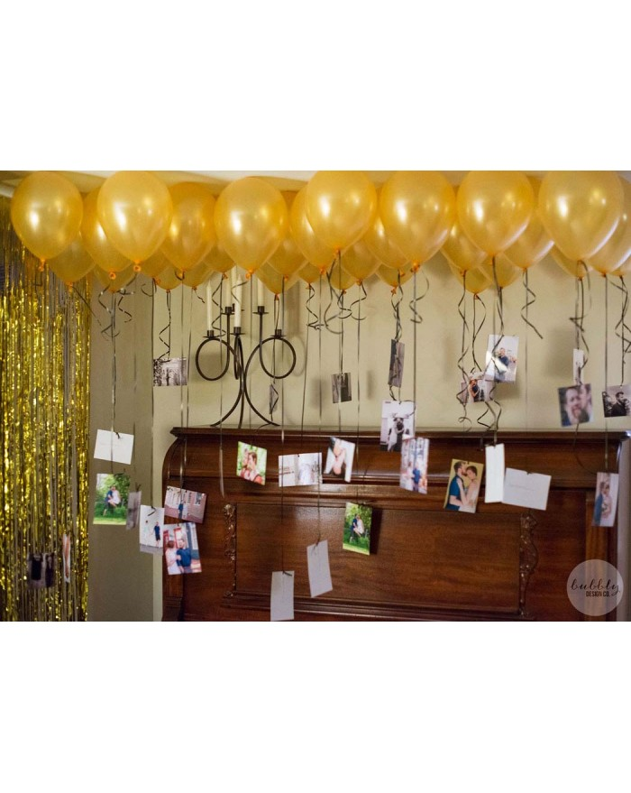 Balloon decoration with hanging photographs
